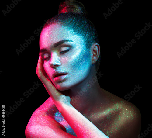 Foto op Plexiglas Beauty Fashion model woman in colorful bright sparkles and neon lights posing in studio, portrait of beautiful sexy girl. Art design colorful vivid makeup