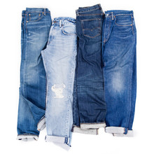 Blue Jeans In A Row Isolated On A White Background, Stack Of Denim Pants, Jeans Texture, Composition