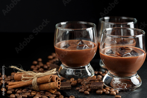 Tuinposter Chocolade glasses of cream coffee cocktail or chocolate martini on black background
