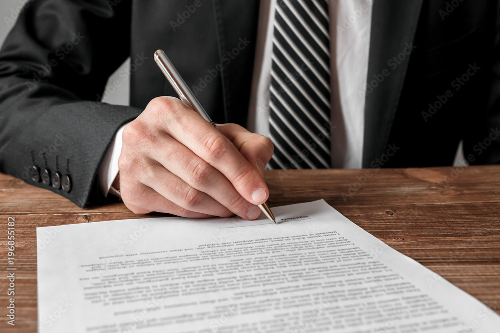 Fototapeta Businessman signing a document.