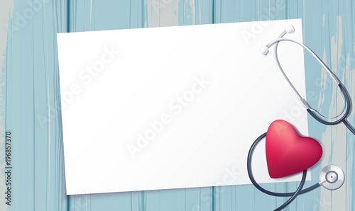 Fotografia Pink heart and stethoscope on blue wooden baclground