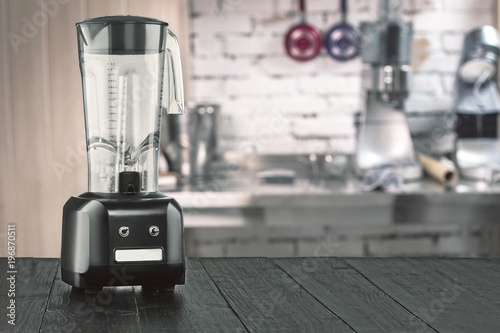 Photo  Blender and wooden table in kitchen
