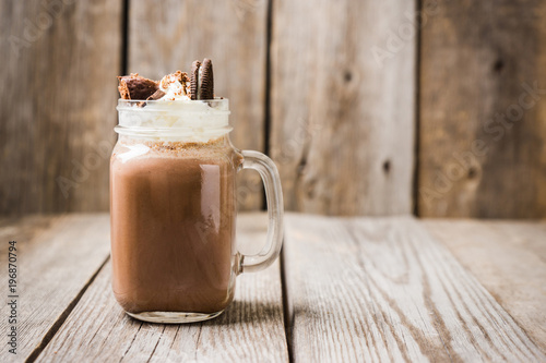 Staande foto Milkshake Chocolate milkshake on the rustic background. Selective focus.