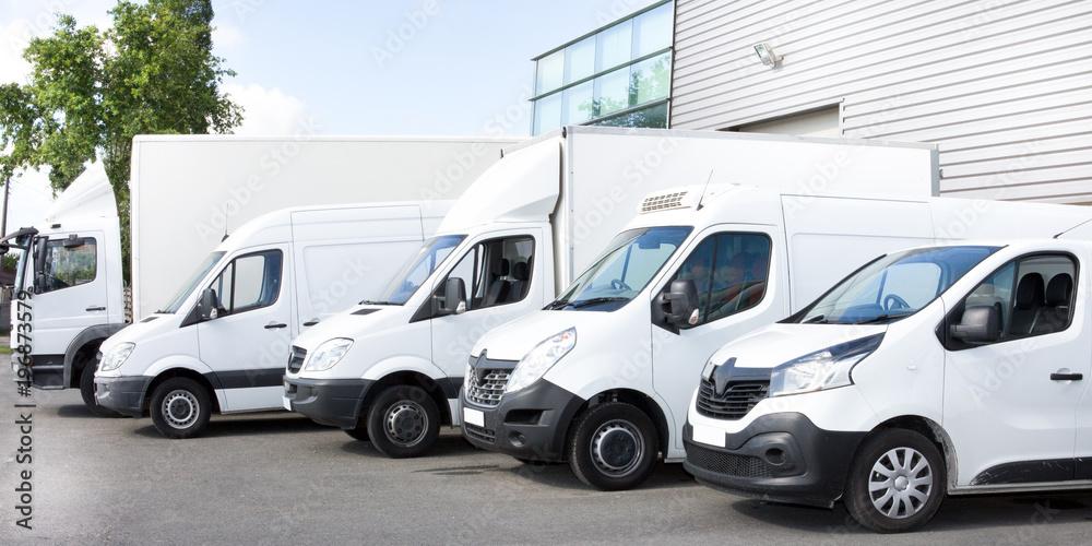Fototapeta Several cars vans trucks parked in parking lot for rent or delivery