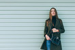 Leinwanddruck Bild - Attractive girl with long hair in a green coat