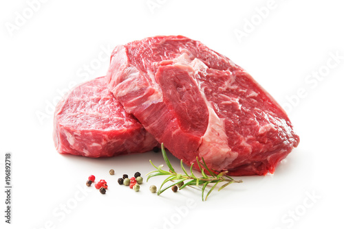 Fototapeta fresh raw rib eye steaks isolated on white obraz