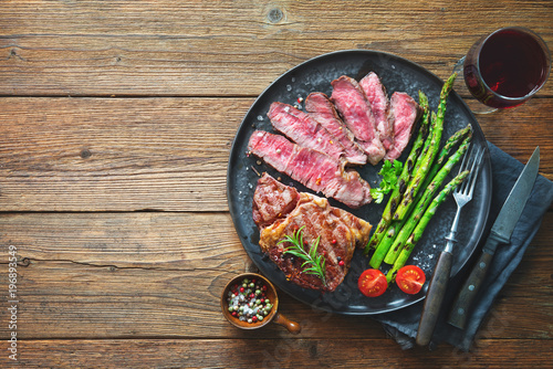 Aluminium Prints Grill / Barbecue Roasted rib eye steak with green asparagus and wine