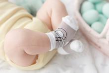 Newborn Baby Legs In Socks On ...