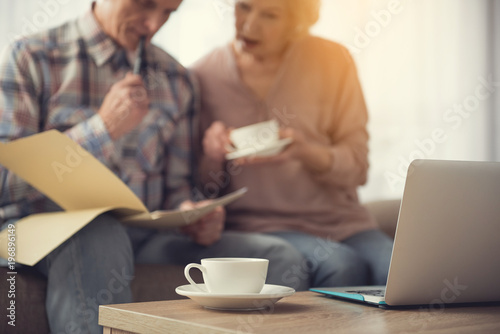 Cuadros en Lienzo  Focus on mug and laptop on table
