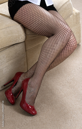 b1513b0bb50 Woman wearing fishnet tights and red high heel shoes - Buy this ...