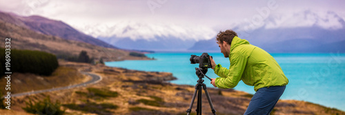 Travel photographer man taking nature video of mountain landscape at Peter's lookout, New Zealand Banner Canvas Print