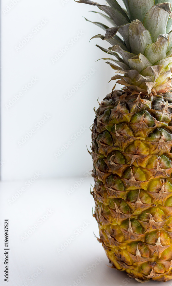 Big ripe yellow pineapple with green leaves close up (closeup). Juicy sweet pineapple. Summer tropical fruits. Ananas fruit isolated. Healthy organic food. Whole pineapple.