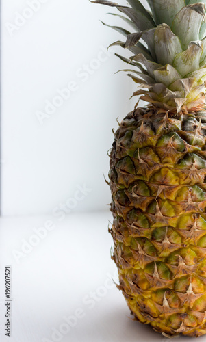 Fototapety, obrazy: Big ripe yellow pineapple with green leaves close up (closeup). Juicy sweet pineapple. Summer tropical fruits. Ananas fruit isolated. Healthy organic food. Whole pineapple.