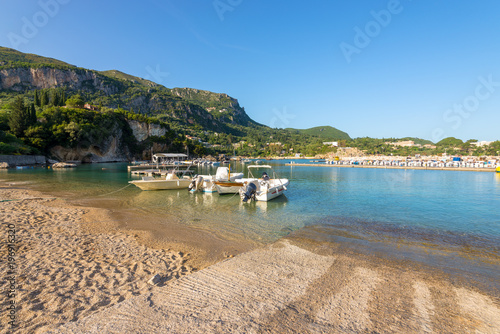 Printed kitchen splashbacks Turkey Boats moored at Alipa beach in Paleokastritsa bay with sand and crystal sea water. Corfu island, Greece.