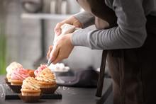 Woman Decorating Tasty Cupcake...