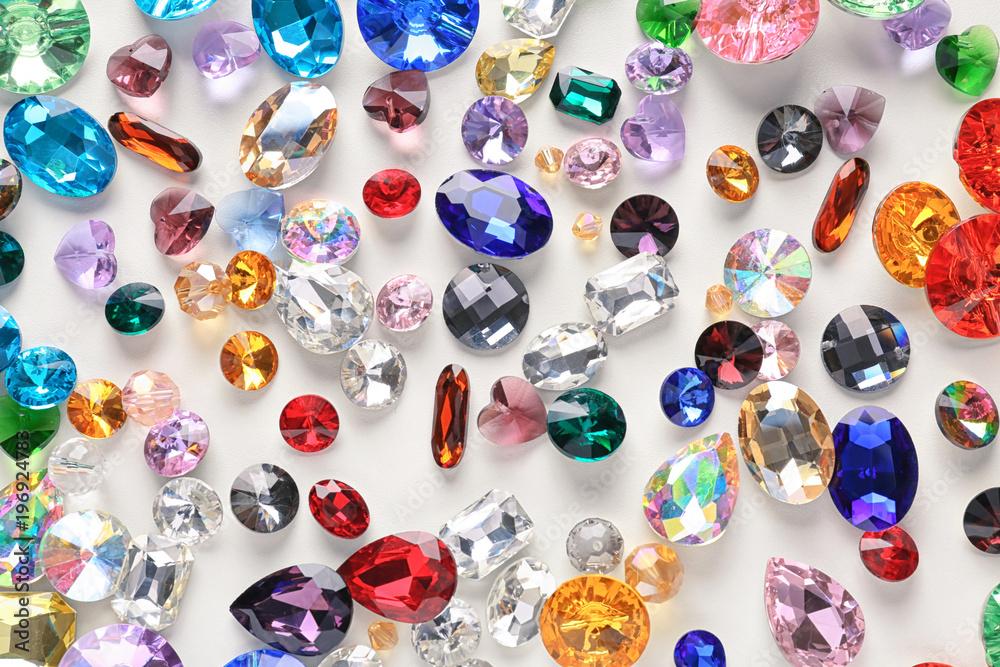 Fototapeta Colorful precious stones for jewellery on white background