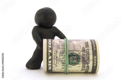 Photo  Black plasticine characters and dollars
