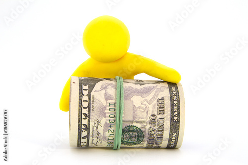 Photo  Yellow plasticine characters and ready cash dollars