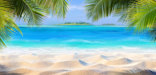 FototapetaTropical Sand With Palm Leaves And Paradise Island