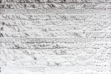 Brick Wall Covered With Snow. ...