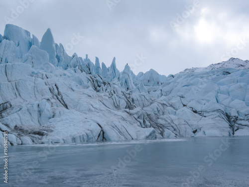 Poster Taupe Ice Climbers on Glacier Seracs in Alaska