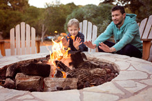 Family By Firepit