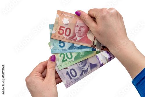 Canadian Dollar On Female Hand Isolated White