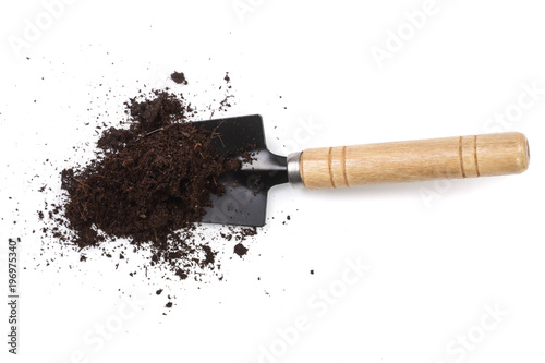 garden tools in soil isolated on white background