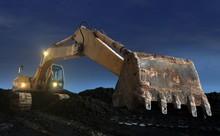 Excavator Digging At Sunset