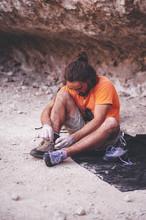 Rock Climber Climbing Lacing His Shoes