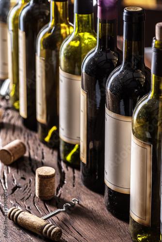 Cuadros en Lienzo Line of wine bottles. Close-up.