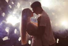 Young Loving Couple On Dark Ba...