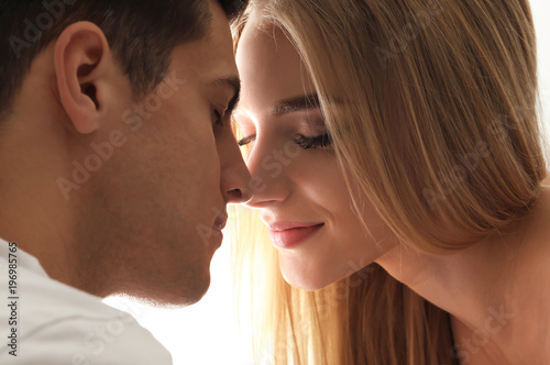 Fotografia  Portrait of young loving couple on white background, closeup