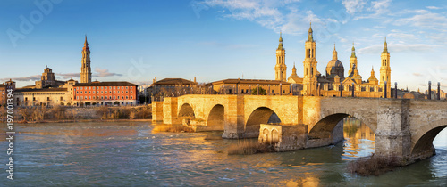 Zaragoza - The panorama with the bridge Puente de Piedra and Basilica del Pilar in the morning light.