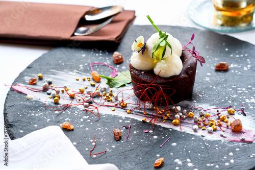 Spoed Foto op Canvas Dessert Chocolate souffle with hot chocolate and mango ice cream