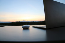 Mouse And Laptops On The Table Silhouette Background With Copy Space