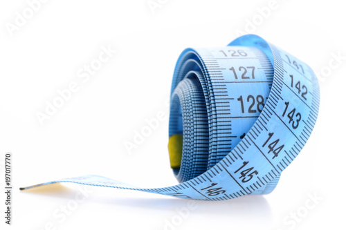 Blue rolled measuring tape isolated on white background.