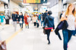 Blurred people in train station movement rush hour