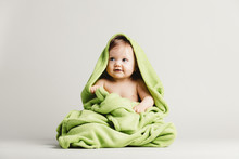 Cute Baby Girl Covered In Green Blanket.