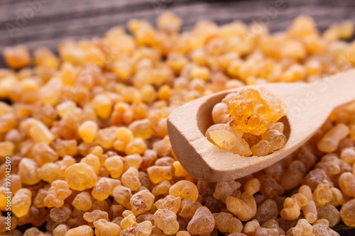 frankincense essential oil on a wooden background Wallpaper Mural