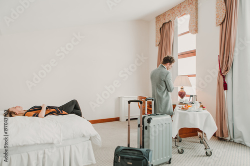 People relaxing in hotel room