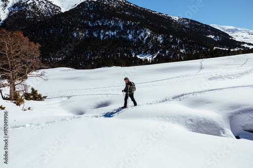 Man walking on snow covered landscape