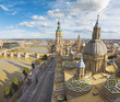 Zaragoza - The cityscape from cathedral Basilica del Pilar tower with the Puente de Piedra bridge,