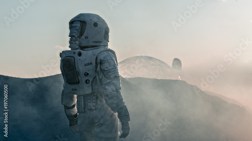 Shot of the Astronaut on Red Planet Watching Toward His Base/Research Station. Near Future First Manned Mission To Mars, Technological Advance Brings Space Exploration, Colonization. - 197060500