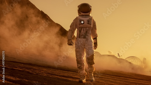 Fotografie, Obraz  Brave Astronaut Confidently Walks on Mars Surface