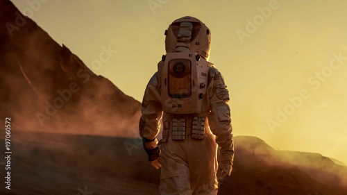 Photo  Shot of Astronaut Confidently Walking on Mars
