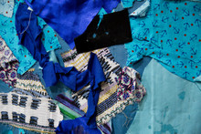 Concept: Do It Yourself Homemade Bed Cover. Abstract Texture Background Made Of Fabric Pieces. Pieces Of Blue Coloured Fabric. Patchwork.