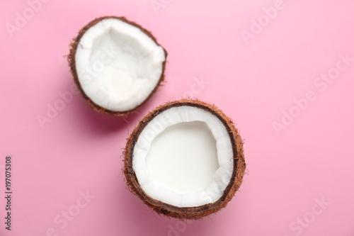 Nut with fresh coconut milk on color background