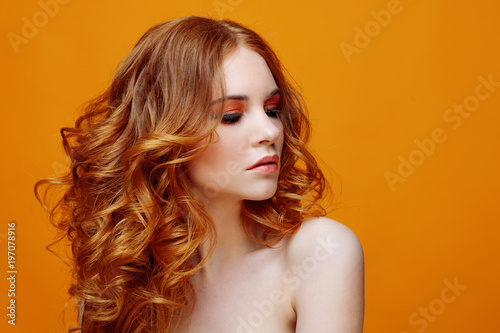 Beautiful redheaded girl with luxurious curly hair Wallpaper Mural