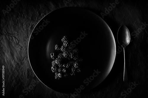 Blackberries on black plate